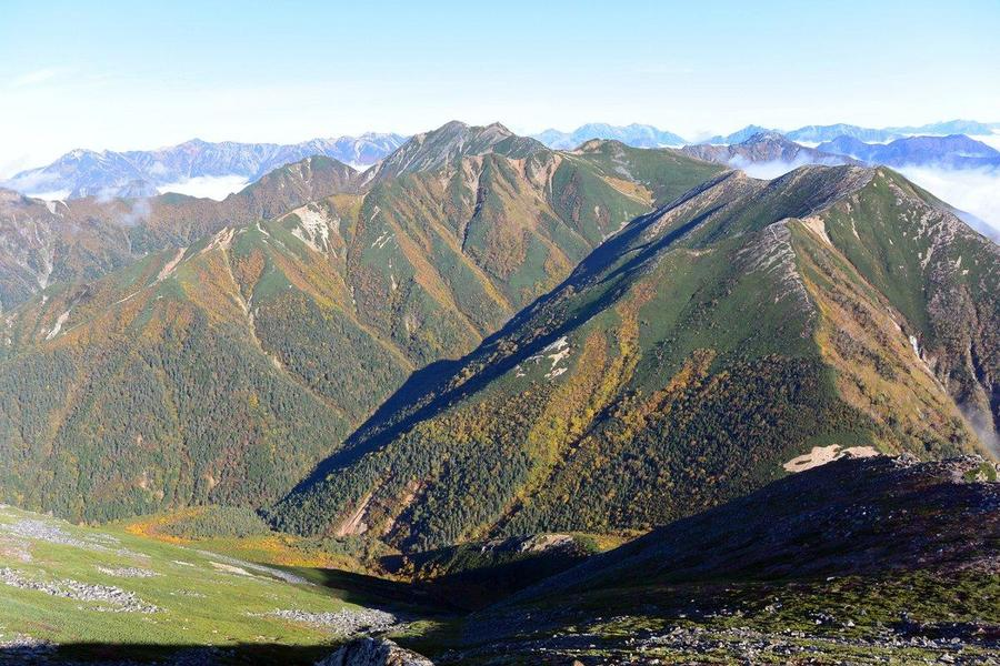 You get a sweeping view of the mountains you've hiked through